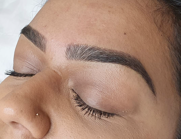 Image of a woman's eyebrow after being sculpted.